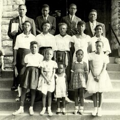 Constance (row 1, 2nd from L)  enjoyed singing and began at age 7 with the New Birth Chorus.