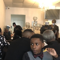 Deceased's grandson, Sokipiriye and family at reception with