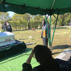 Deceased's son-in-law paying respect