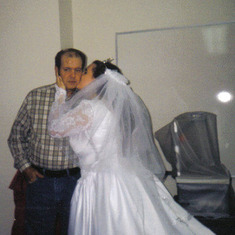 me kissing daddy on my wedding day