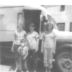 Carol and cousins in front of the dairy milk truck