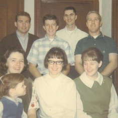 Boys and girls: First row - Carol (with Katherine on her lap), Kathi, Sally; Second row - Dean Curry, Bill Markley, Jim Owens, Derrell Slatten
