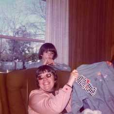 Gertrude appliqued the shirt for Carol; Jeff in background