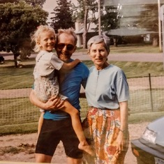 Chet with Donna and granddaughter Sonia in Aitkin, MN, ~1996 (in biking gear, of course!)