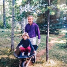 "Chet and granddaughter Sonia ""doing work"" at the cabin, ~1997"