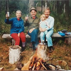 Donna, Cass (Chet's brother), Chet, and granddaughter Sonia at the cabin, 1992.