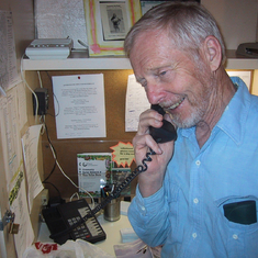 Chet answering the phone at St. Stephen's shelter