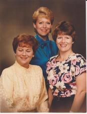 "L-R: Constance ""Connie"" Miller and daughters, Patricia (blue blouse) and Valerie (floral blouse)"