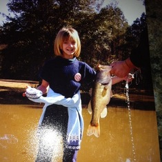 She caught this 3 1/2 lb bass in my pond in back of property