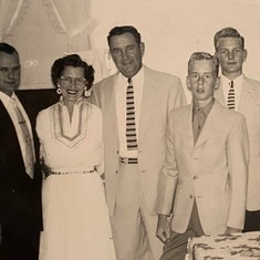Madge and Dick Bennett with their three sons around 1952