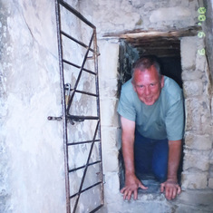 Crawling through Balcony House at Mesa Verde June 2000