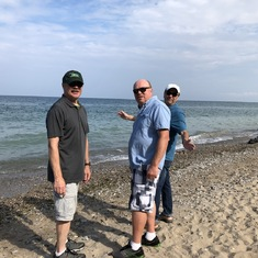 Dennis, Dave and Tom skipping stones.