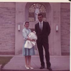 Denise and Frank holding Marty  /  Marty's Godparents .