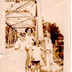 With her mom and brother John. Back of photo says 1937 but I don't recognize the bridge. Anyone?