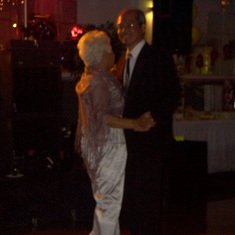Lola and Uncle Kiko dancing at her 90th Birthday Party