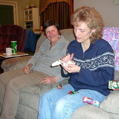 Opening Em's gifts (she always had a knack for that) -Christmas 2006