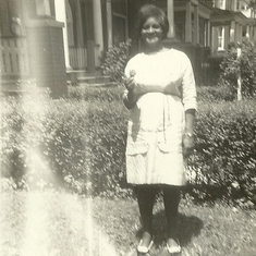 Mother visiting Canada, standing outside the house where we lived, located downtown Toronto, close to Dufferin St.
