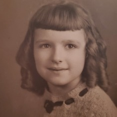 Felicia as a young child.  She was told her ringlets made her look like Shirley Temple
