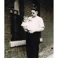 Fran held by his father, 1938