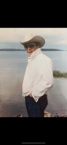 This photo was taken of our dad at Great Slave Lake in the Northern Territories of Canada. It is our favorite photo of our dad.