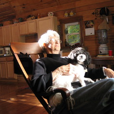 A favorite photo of her at our cabin in Hocking County, 2008. Sun on face, dog on lap. Happy.