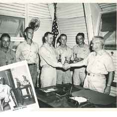 George, center, is congratulated as he wins another trophy. Photo insert shows George in his dress whites.