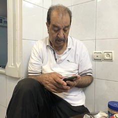 Dad Ghassem and his smart phone