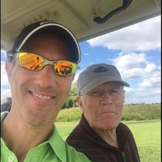 Glenn playing golf with his JP Morgan financial advisor and friend, Matthew