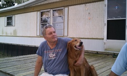 "Greg on his back porch, with his neighbor's dog ""Buddy"", enjoying the view of Escambia Bay."
