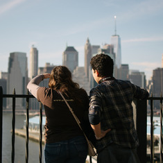 Tori & Gregory, looking out to Lower Manhattan from Brooklyn Heights. February 2017.