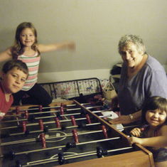 Playing fooseball with her grandkids
