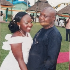 Dad and his daughter Oby at her wedding ceremony 2009