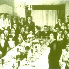 Jay as a a child at a Passover Seder (on his father's lap, far right)