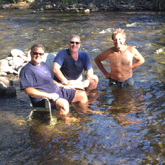 Kevin, Edward, and Neal cooling off in the creek.