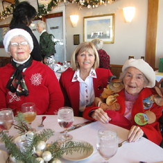 Dale Hoeffliger between Jean and mother Vivian at the Sage Hens Christmas luncheon at the SB Yacht C