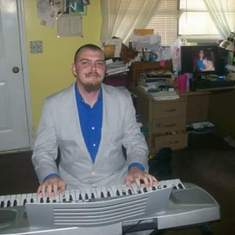 Jesse playing my keyboard. He loved playing the keyboard and the guitar