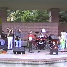Right side of stage is Jimi Lineham, our kids and friends jamming at the park - 1992.