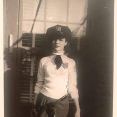 Joan wearing her father's police uniform