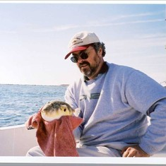 John with a pufferfish. He always had a knack for getting picked on by bait stealers.