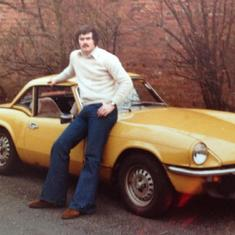 John by his car in 1978. One stylish dude.
