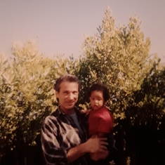 John with baby Jahfari in our garden at the big house in Petaluma