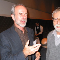 Beau Watson instructing John on the finer things in life at the Tillyer Award banquet, 2004