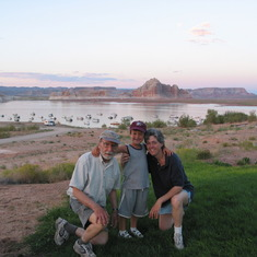 John, David, and Sharon on vacation at Lake Powell in 2004 (no, that's not a fake background).