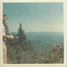 Dad looking out over the vista from Mt. Chocoura during a family day hike while vacationing at Lake Winnipesaukee in the summer, probably 1965. Note his white and yellow meerchaum pipe of which he was rather proud.