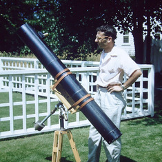 Re-upload of this picture of Dad with his telescope. (The first was flipped backwards.) He built this telescope and ground the lens in the living room of our apartment in Providence, which would be c. 1956-59. Does anyone recognize the location?