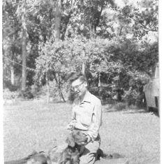 Dad and one of their Irish Setters, probably George, probably in Fort Knox