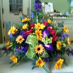 His father's day flowers I put for him at the cemetery because he loved bright colors.