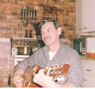Dad playing the guitar 001