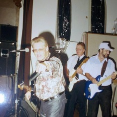 Uncle Charlie is pointing @ the camera and Dad is in the back playing guitar @ my reception 1992