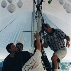 """Here's another great memory of Ken;  steadying the ladder for Peter Wiley (known for being deathly afraid of heights) charged with the task of mounting he lighting within the tent @ Mary Kelly's cottage; who graciously hosted Kim & Ken's reception, becau"